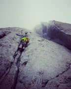 Nate during our Patagonian conditions ascent. The chimneys on P12 were completely iced over so we opted for the cracks out left.