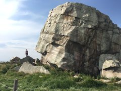 April standing on the South West corner of the West Boulder. Gives you a scope of the size. She's five feet tall.