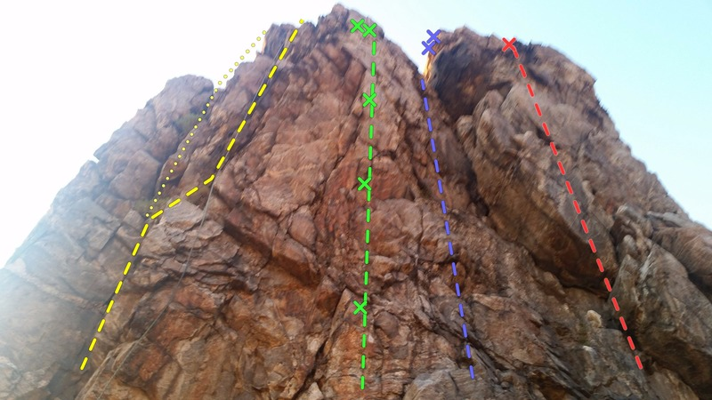 This is the back side(east) of the main house crag. <br> L-R<br> Yellow - Klingon Arete (5.6 or 5.7)<br> Green - Suck it up Princess (5.9)<br> Violet - Batman Surprise (5.6)<br> Red - Basket Case (5.7)