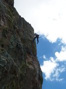 Mike Kane demonstrating why JBak christened this route Public Hanging.