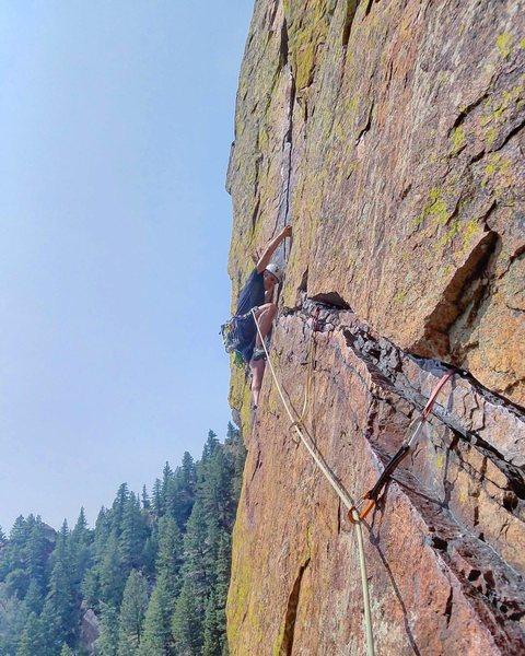 Climbing crux pitch of Rewritten