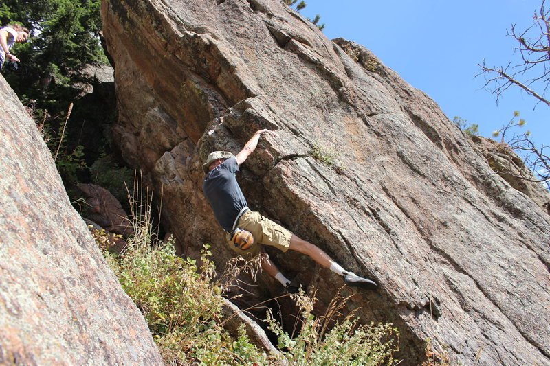 After moving up from start and beginning the traverse. Acme handhold is near elbow.