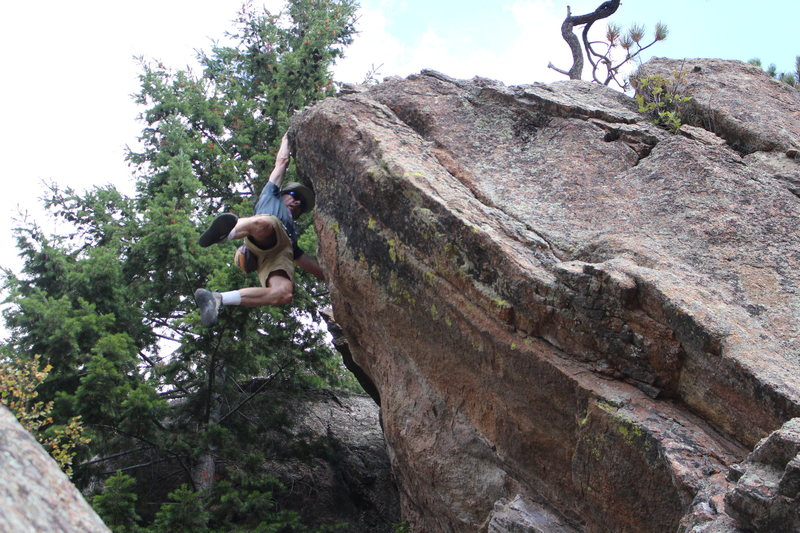 Rock Climbing Photo: Lunge for top, you can let the feet swing out for ...