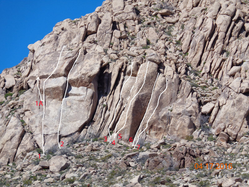 Knob Hill south face, photo courtesy of Dustin Wilkinson<br> 1) Unknown crack to face, 5.9R<br> 1A) Sneak Around, avoids the R finish<br> 2) The Moon, 5.8<br> 3) Ghosts of the Glory Trail, 5.9<br> 4) Chimney, 5.7<br> 5) Low Flying Monkey, 5.7<br> 6) Wide crack, 5.9<br> 7) Thin seam, 5.10