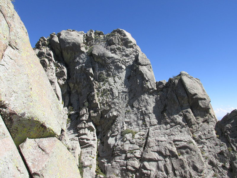 North face of the Wedge as seen from the West Ridge of Lost Peak. The two large steps are surmounted by pitches 3 and 4 of the West Ridge route.