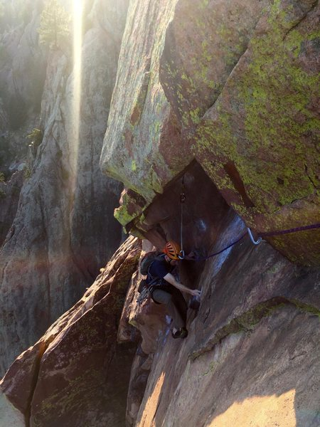 Dan Cohn entering the P4 crux section@SEMICOLON@ the spectacular time of day made the climbing on this pitch particularly spectacular. The @POUND@2 Mastercam out left with a long sling would probably hold a fall as well as the @POUND@1 MC below the fixed pin (cleaned here, previously at his feet). Definitely one of the finest climbs in America, though there are too many to truly quantify that statement.