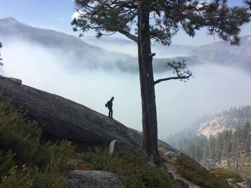 Base of Half Dome/Snake Dike with smoke from the valley below.