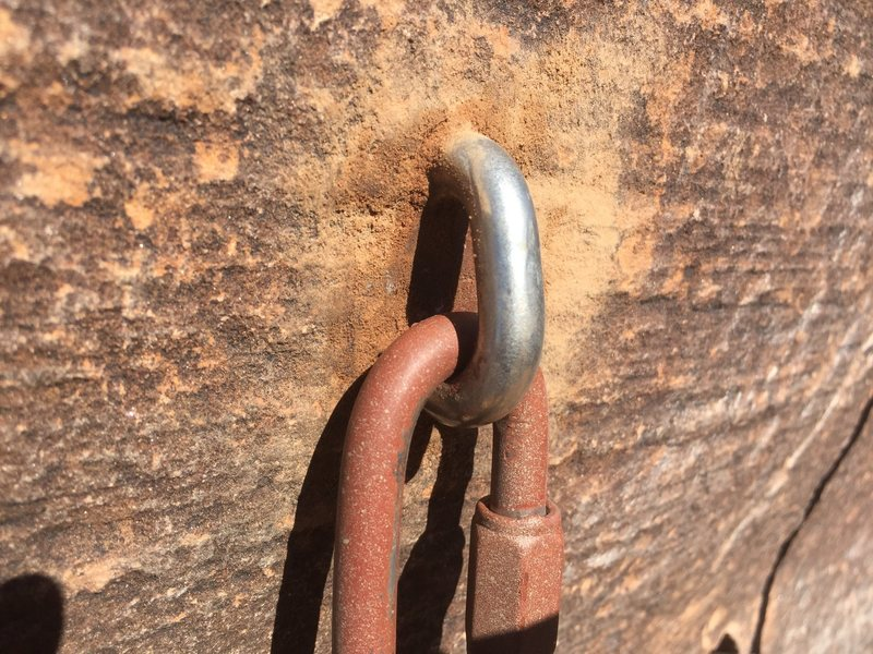 Closeup of new top anchor bolt with new stainless steel quick link.