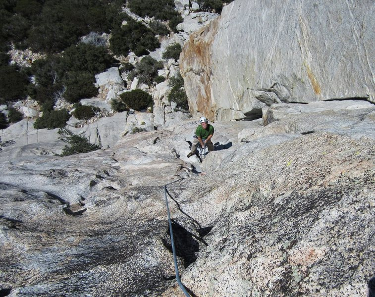 View down the crux  of the second pitch, Mike McKay at the belay.<br> <br> Photo by Bob Gaines