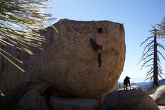 "S.S. topping out his project: ""Fun Times in Bethlehem"" on the B-1 Boulder in Horse Flats, CA."