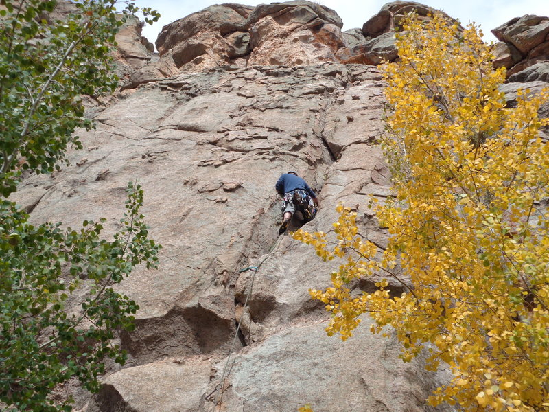 Me leading the 5.6 crack route. Just left of the 5.7s with the bolts and chickenheads.