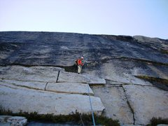 Warm Black Knobs: Herb Laeger at belay/rap station for 3rd pitch. Late in the day after completing FA with Gary Sullivan, swapping lead bolting often on this thin but rewarding pitch.