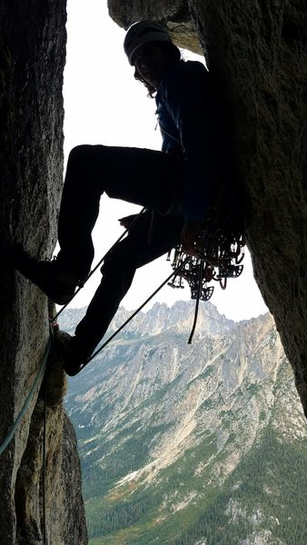 Exiting the belay chimney to the traverse and crux lieback