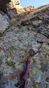 Rock Climbing Photo: A rusty relic with a pice of someones cordelette t...