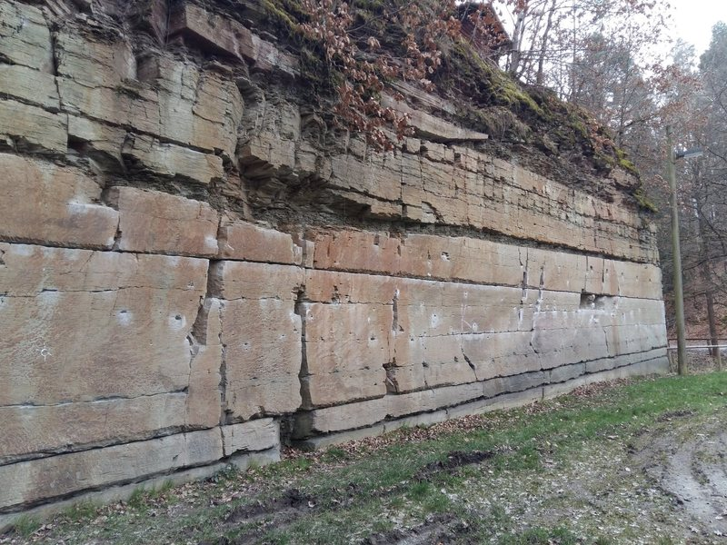 """One of the two """"bouldering"""" walls of the quarry. this has the upper/lower traverse routes as seen by chalk marks"""