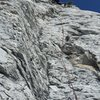 Carl at the crux of the second pitch. Continues technical climbing once you leave the belay stance.