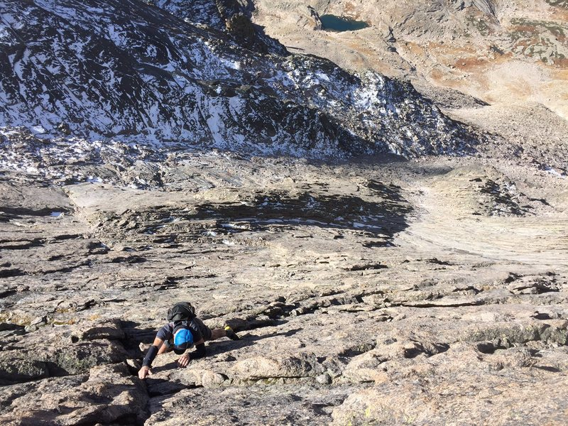 Justin Simoni on Van Diver's West Wall. Note the top of the triangular buttress just over his right shoulder.