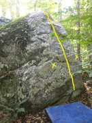start with your feet on the separate chunk of rock at the bottom of the boulder. place your hands roughly in the location marked by the X's (one hand should be on the arete)