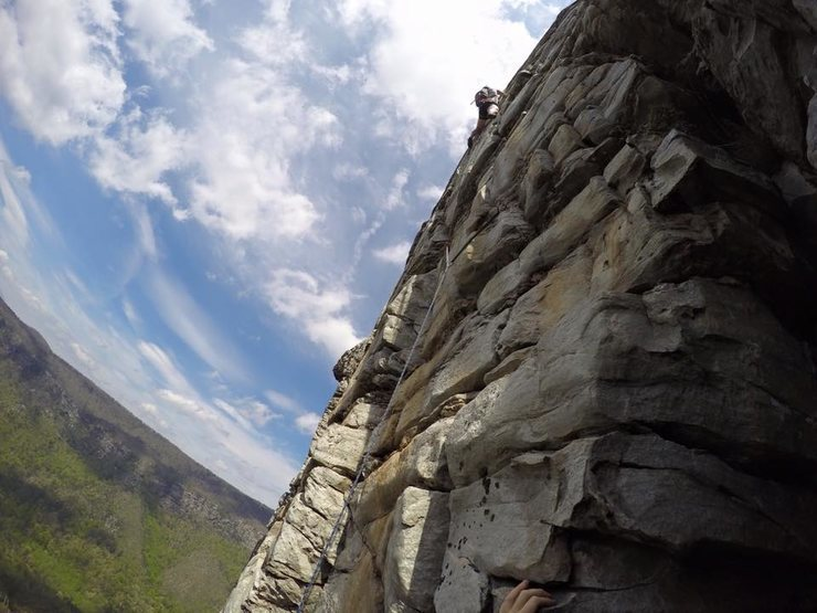 Probably pumped and smiling. Just after the crux.