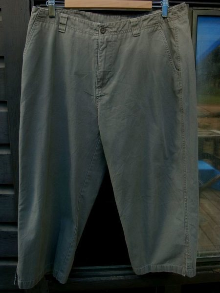 100% very light olive cotton fabric with a soft hand. Belt loops, no waist elastic, hand and 2 rear Velcro closure patch pockets. These are somewhat plain, no frills, yet very nice gently weathered Capri's in excellent condition