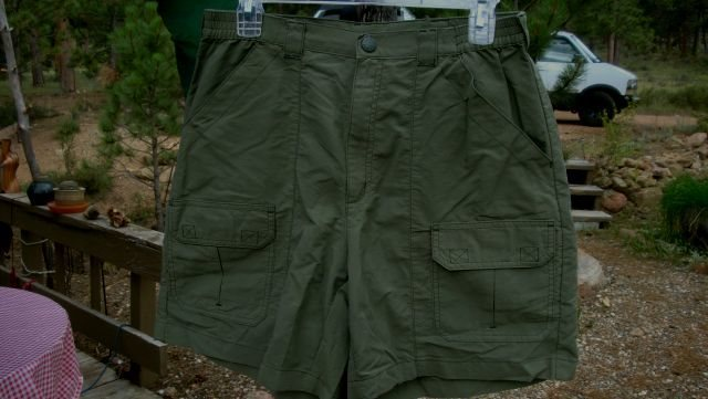 Size 12, olive green in color. Belt loops and partial elastic waist, hand pockets, Velcro closure front cargo pockets and rear pockets. Excellent, hardly used condition.