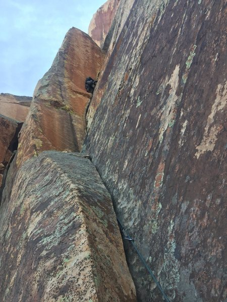 Sam leading handcrack pitch with thrutching 11b exit. Bad rock section isn't that bad, good pro and jams.