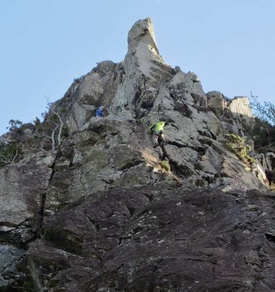 Andy topping out to the belay below the crux pitch of the Super Direct