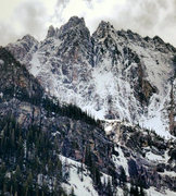 The massive Southeast Face of A peak in the winter, taken from Granite Lake