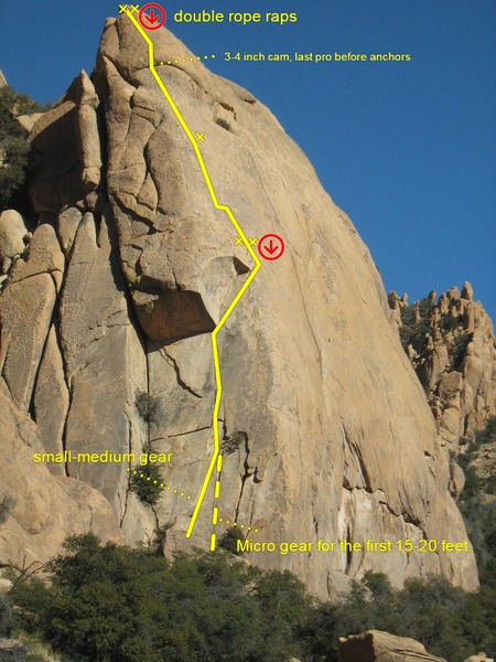2 starts. The left route is up a flake. Or face climb and use finger tips up the right crack for 15' (PG-13ish, micro gear). I rappelled straight down the route with 2 ropes. Pic by Brad Schierer
