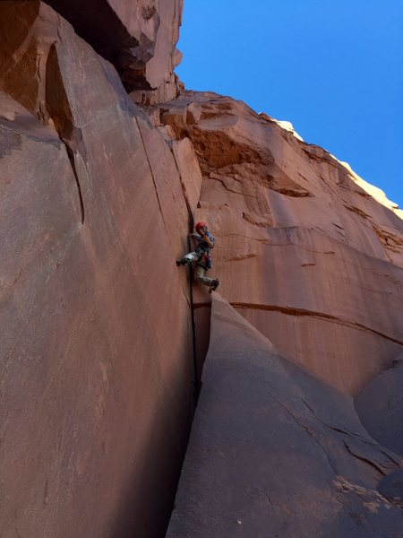 Parnas pulling the overhang to reach the second belay.