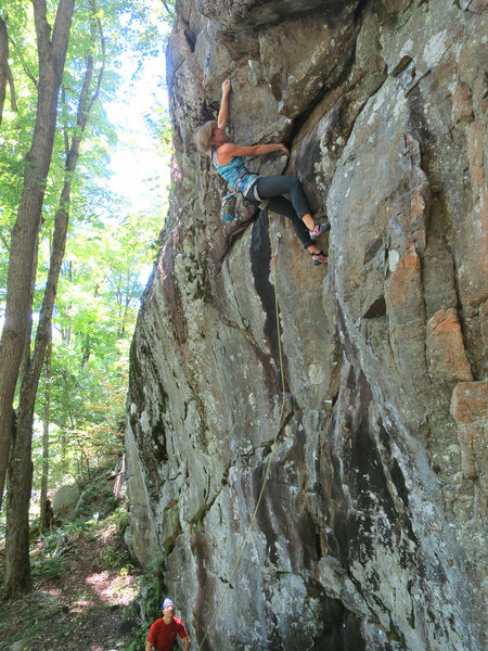 Climber on The Get Down (5.11a), Chatiemac Cliff, Adirondacks.