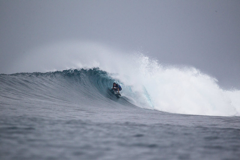 Squeezing into a small barrel in Indonesia.