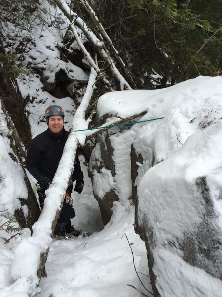 Alex smiles before heading up to the out of the falling ice belay at the top of pitch 1