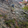 """Photo#14 - P7  S Matz climbs up the slab, then will traverse right to the """"ugly corner""""."""