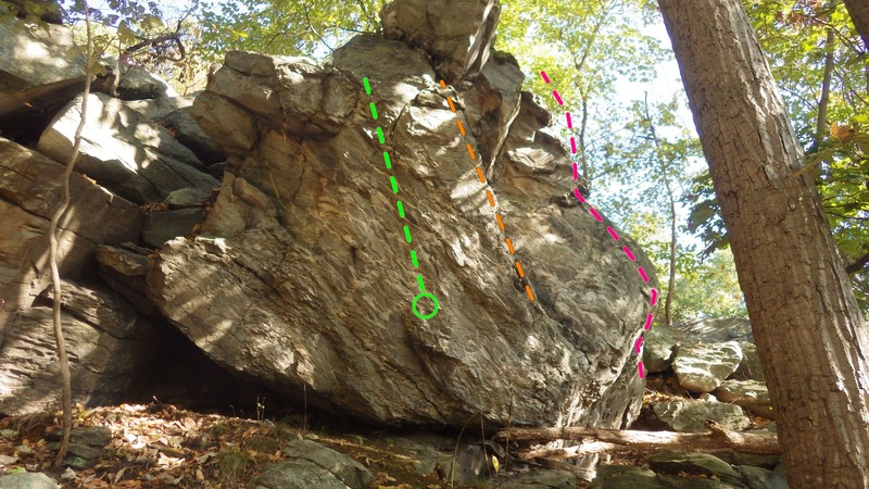 Tossed Alice (orange) and Tipping Fee (green) are on the right side of the face visible in the pic. Duped by a Rubber Goat (pink) starts around the corner and comes to the blunt arete and climbs upward.