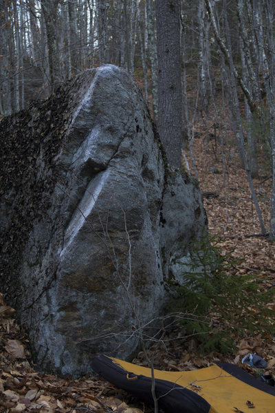 The bottom arete of this boulder. Start with hands and feet split on either side.