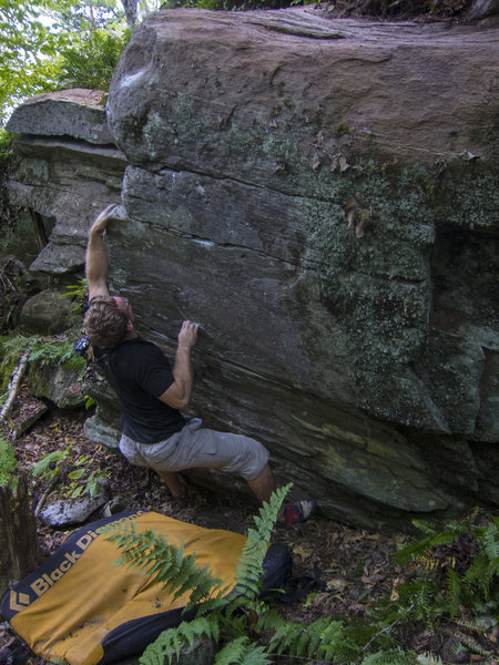Rock Climbing Photo: Making the first move.