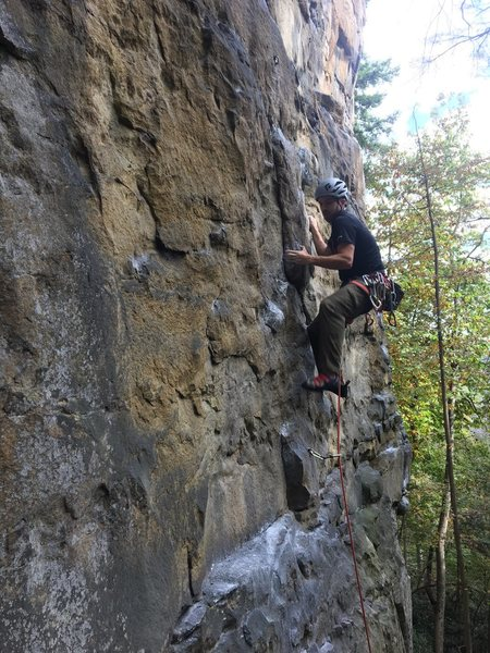 Easy climbing down low, send someone with a camera up to the ledge on climbers left.