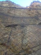 Rock Climbing Photo: The route is behind the wire curtain but can still...