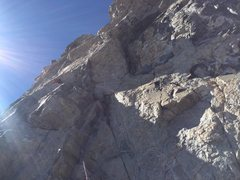 Beginning of leftward traverse along ledge, pendulum pitch.