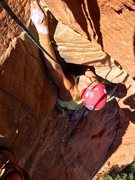 Rock Climbing Photo: Emma reaching up to pull the roof at the top of P1...