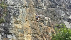 The route can be determined by its yellow color. Here you can see Chloe, a local climber, about 5 feet below the crux.