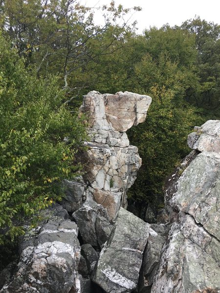 The classic view of the Wolf's Head Pillar from the top of Wolf Rock