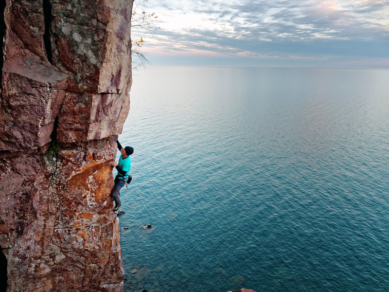 Sailing Superior Arete high above evening waters of Lake Superior. Photo: Ellen Brodrick.
