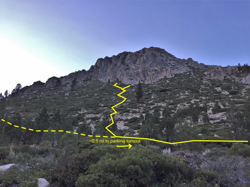 """Approx approach path up the slope after the initial ~1/2 mile of flat travel parallel to the road from the parking area. The turn right up the slope is easy to miss. In general look for the large lone pine tree in the middle of the slope. The loose """"path"""" goes to the left of this tree."""