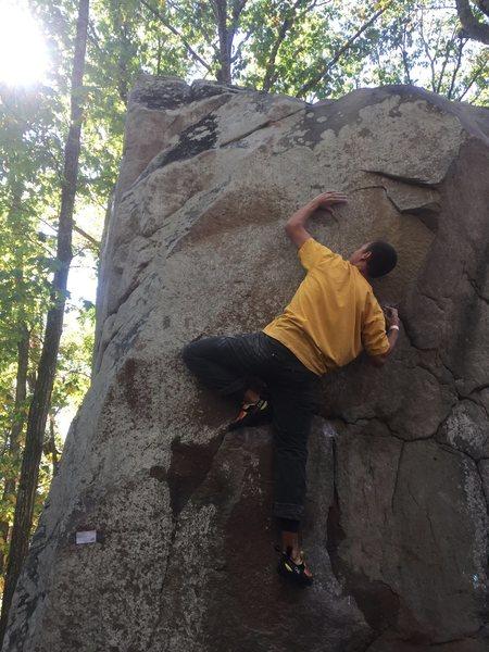 Jacob Kansco using thumb on left crimp to move left.