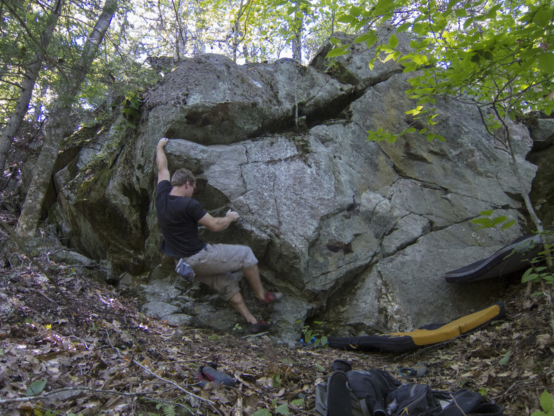 Making the first move, shared with Learning to Stand (V2), before attempting to rock up/dyno to the edge on the lip/nose.