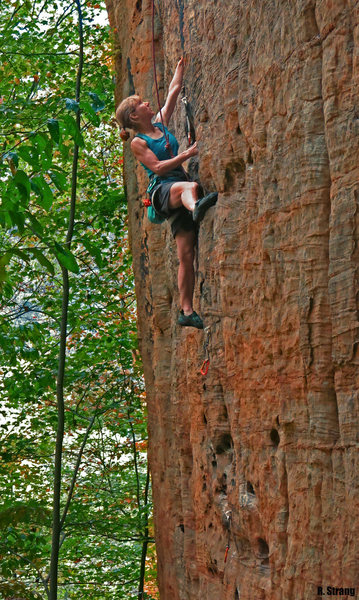 Susan at the under-cling crux on<br> Theobroma (5.10d)