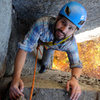 """Jeremy Robichaud topping out """"Stem It"""" 5.10d a wide chimney reminiscent of the majority of routes at Devil's Tower, WY."""