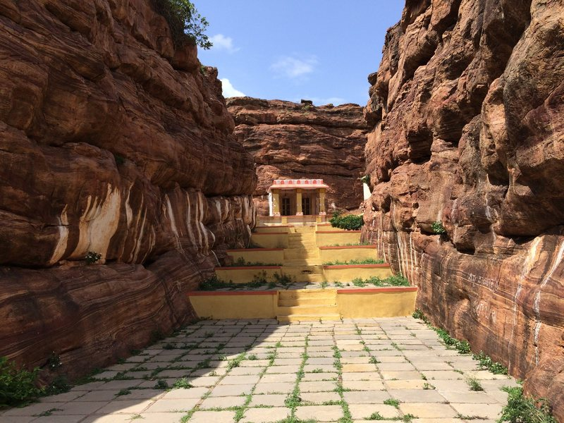 The temple area climbs are mostly to your right if you are facing the temple.